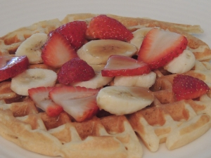 banana, strawberry and maple syrup waffle