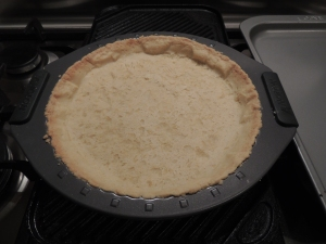Let cooked tart base cool