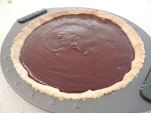 Chill the chocolate ganache tart in the fridge