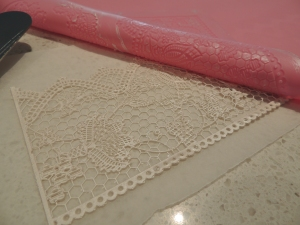 Slowly peel off the lace once it has baked in the oven