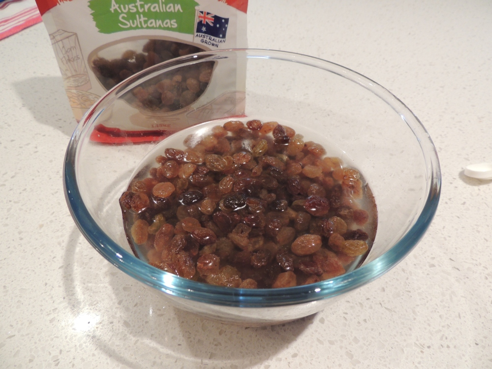 Soak sultanas in hot water