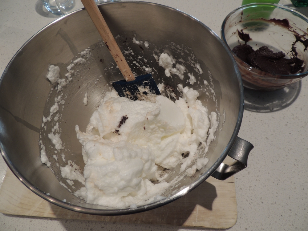 Gently fold egg whites into the chocolate mix